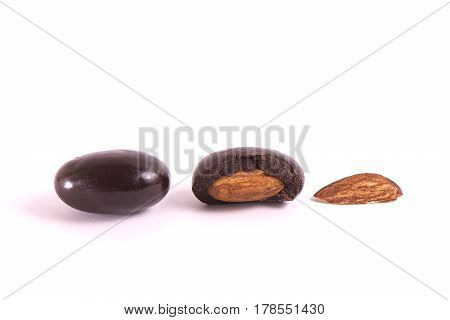 Group Of Nuts In Chocolate On A White Background. Part Cut In Half.