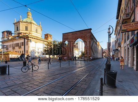 MILAN ITALY - September 12 2016: View on The Basilica of San Lorenzo Maggiore San Lorenzo Columns and the tram's railways on the Corso di Porta Ticinese on the summer evening.