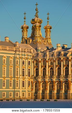 Domes of Church of the Resurrection of Catherine Palace in beams of the sunset sun close up. Tsarskoye Selo. Russia