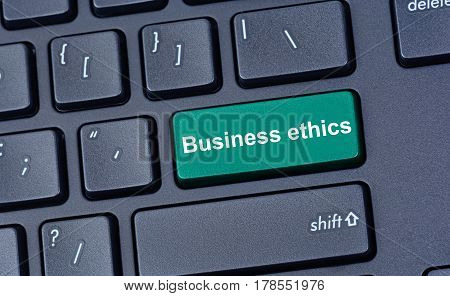Business ethics words on computer keyboard button