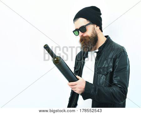 Bearded Brutal Caucasian Hipster Holding Bottle