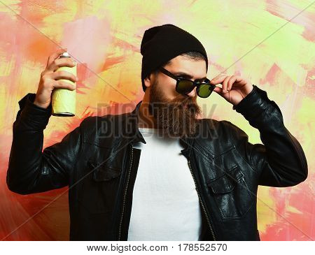 Bearded Brutal Caucasian Hipster Holding Spray Paint