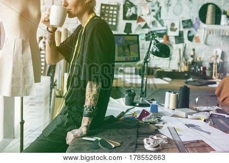 Fashion designer having a break with coffee