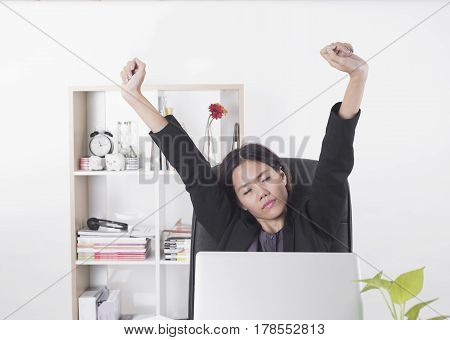 Businesswomen working at office desk.she feels bored and tried job on laptop. relax concept.