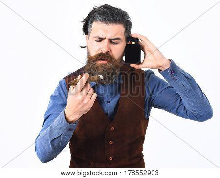 Bearded Man Smoking Cigar With Serious Face, Holding Perfume