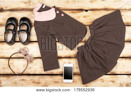 Beauty set of girl's fashion and accessories on wooden background