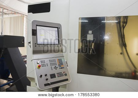 Industrial remote control panel of metal working manufactory, close up