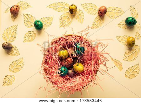 Easter Color Quail Eggs On A White Background,..leaves Cut From P
