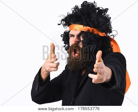 Bearded man long beard. Brutal caucasian hipster with moustache have suit and black curly tie-tied afro wig isolated on white studio background