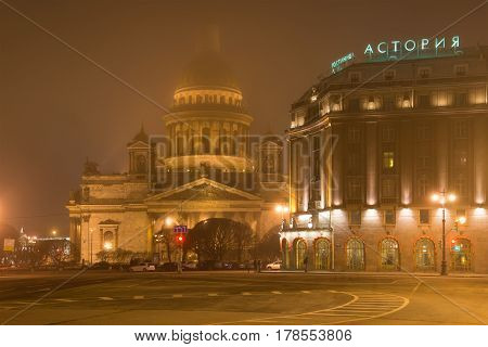 SAINT PETERSBURG, RUSSIA - MARCH 12, 2017: St. Isaac's Cathedral and Astoria hotel foggy March night