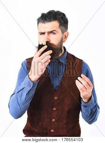 Bearded Man Sniffing Perfume With Serious Face