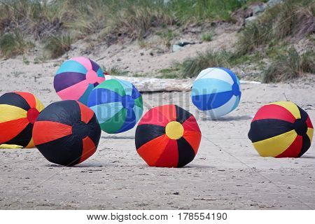 Colorful Inflated Beach Balls at a Kite Festival
