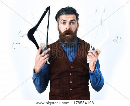 Bearded Man Holding Clothes Racks With Surprised Face