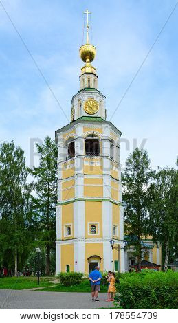 UGLICH RUSSIA - JULY 19 2016: Unknown tourists are near belfry of Savior-Transfiguration Cathedral of Uglich Kremlin Russia