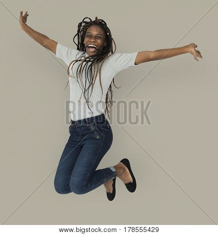 African woman jumping active smiling