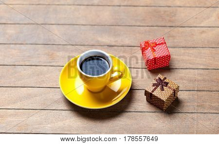 Photo Of Cup Of Coffee And Cute Wrapped Gifts On The Wonderful Brown Wooden Background