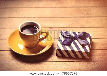 Photo Of Cup Of Coffee And Cute Wrapped Gift On The Wonderful Brown Wooden Background