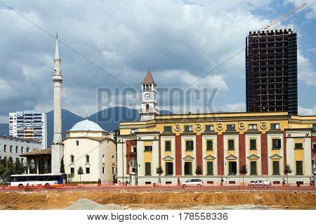 TIRANA, ALBANIA, MAY 14, 2010:  Et'hem Bey mosque and Clock Tower on Skanderbeg square of Tirana