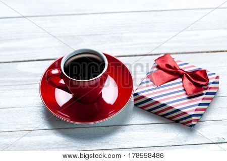 Photo Of Cup Of Coffee And Cute Wrapped Gift On The Wonderful White Wooden Background