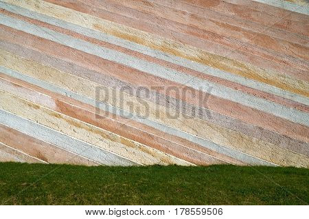 Grass with a stone wall - perfect background for your concept or project