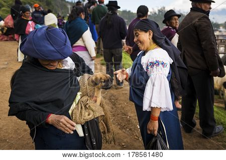 Otavalo Ecuador - February 1 2014: Two local women talking at the livestock market of the town of Otavalo in Ecuador.