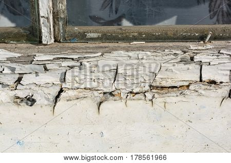Closeup of old obsolete thick white paint on wooden wall