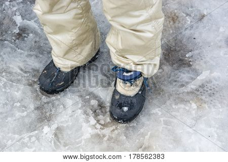 Close up of hiking shoes on slush in winter
