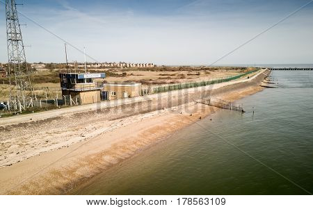 Aerial view of a UK Coastguard lookout tower on the north bank of the Thames Estuary in Essex England.