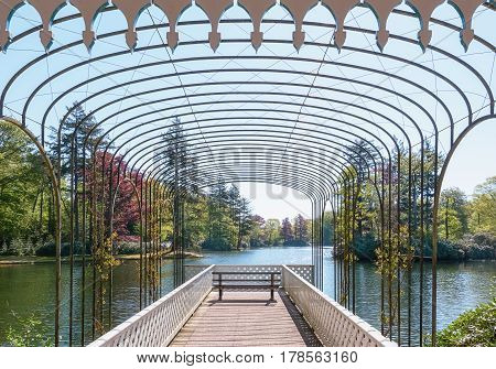 Romantic scaffold spanned by a graceful arcade in The Loo park in Apeldoorn in The Netherlands