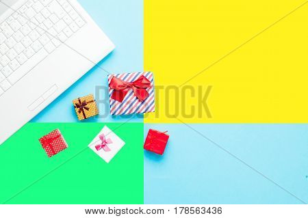 Cute Gifts And Silver Laptop On The Wonderful Colorful  Background In Pop Art Style