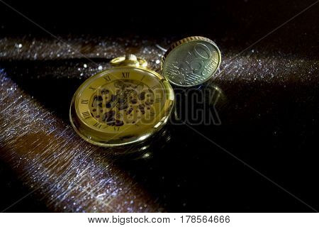 concept of the value of the money in the time with a clock and a money