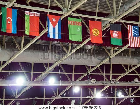Flags Of Different Countries Hang Over The Sports Arena