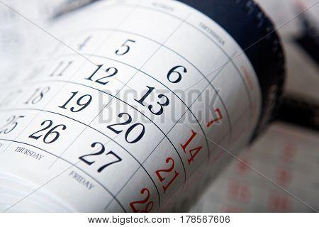 pile of wall calendar sheets close up