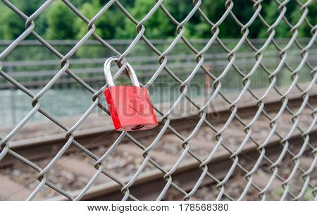 Padlock with heart decorationon on bridge at Rheinfall, largest plain waterfall in Europe