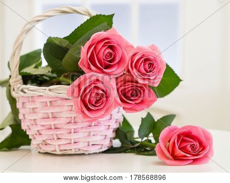 Wicker Basket With Roses On The Background Of The Window