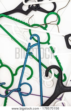 Many Hangers Of Different Shapes And Colors, Top View, White Background
