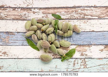 Unripe almonds on vintage table high angle view