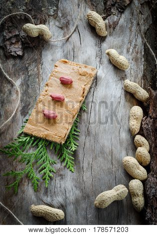 Sandwich With Peanut Butter On The Background Of Old Wood