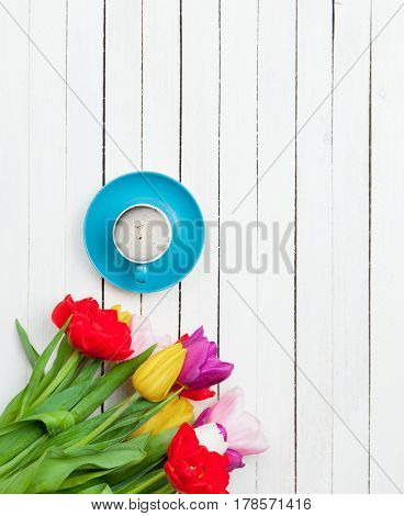 Photo Of Cup Of Coffee And Colorful Tulips On The Wonderful White Wooden Background