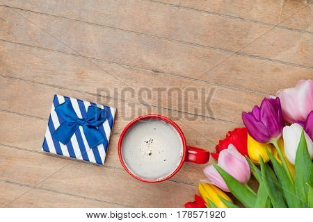 Photo Of Cup Of Coffee, Cute Gift And Colorful Tulips On The Wonderful Brown Wooden Background