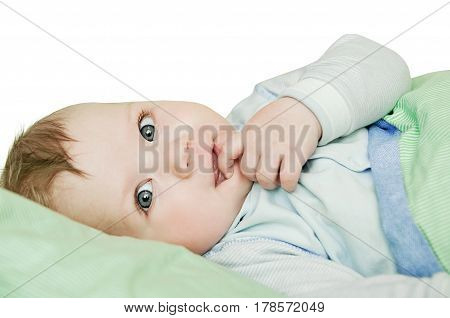 Newborn Child Relaxing In Bed After Bath Or Shower. Nursery For