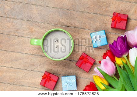 Photo Of Beautiful Bunch Of Colorful Tulips, Cup Of Coffee And Cute Gifts On The Wonderful Brown Woo