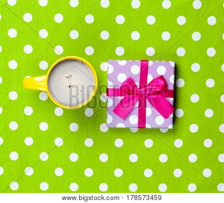 Photo Of Cup Of Coffee And Cute Gift On The Wonderful Green Dotted Background In Pop Art Style