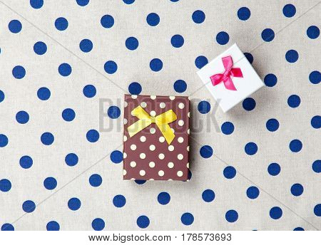 photo of cute gifts on the wonderful white dotted background in pop art style