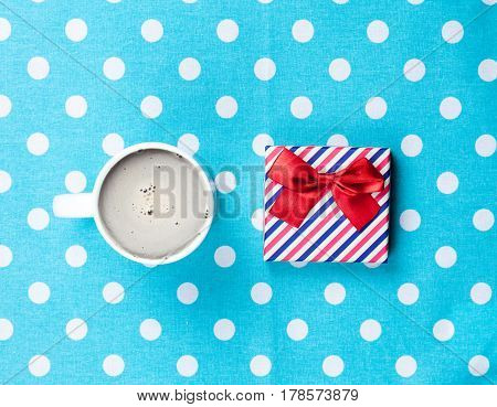 Photo Of Cup Of Coffee And Cute Gift On The Wonderful Blue Dotted Background In Pop Art Style