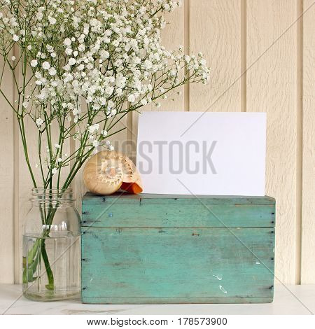 Styled summer beach home interior space with blank notecard for copy.