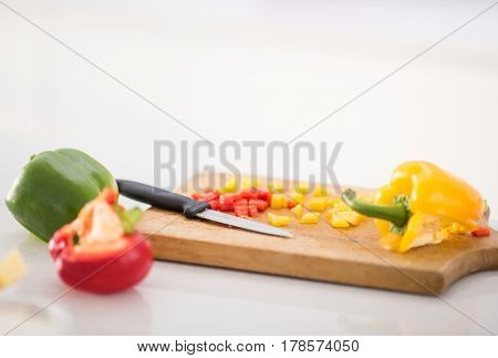 Making salad for lunch in modern kitchen