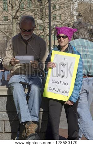 Asheville North Carolina USA - February 25 2017: Senior activists at an Affordable Care Rally with sign protest the proposed Republican healthcare bill