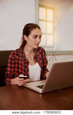 Lovely Young Woman Looking At Laptop