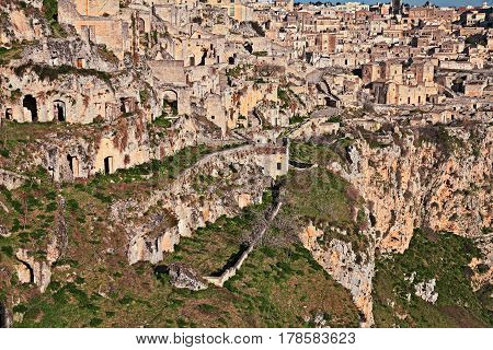 Matera, Basilicata, Italy: landscape at sunrise of the old town (sassi di Matera), with the houses carved into the tufa rock over the deep ravine